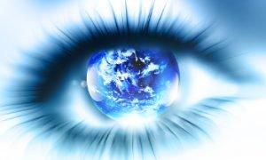 Spiritual Woman With Globe In Her Eye