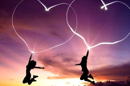 Two Happy People Jumping With Heart-Shaped Auras