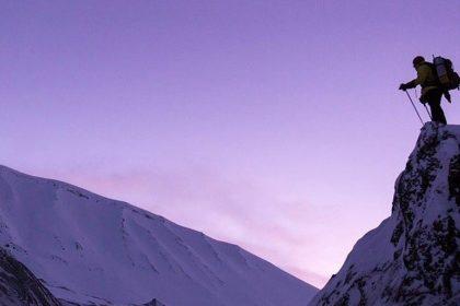 Inspiring Man Standing At Top Of Summit